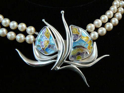 Silver and enamel clasp for earls